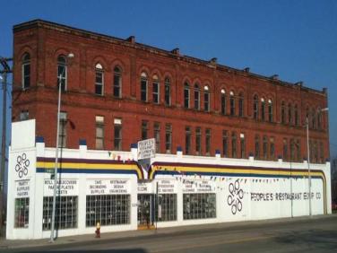 Vintage photo of People's Restaurant Equipment Co's exterior brick building